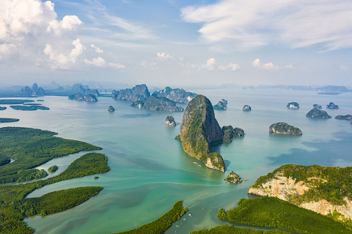 istock View from above, aerial view of the beautiful Phang Nga Bay (Ao Phang Nga National Park) with the sheer limestone karsts that jut vertically out of the emerald-green water, Thailand. 1136936720