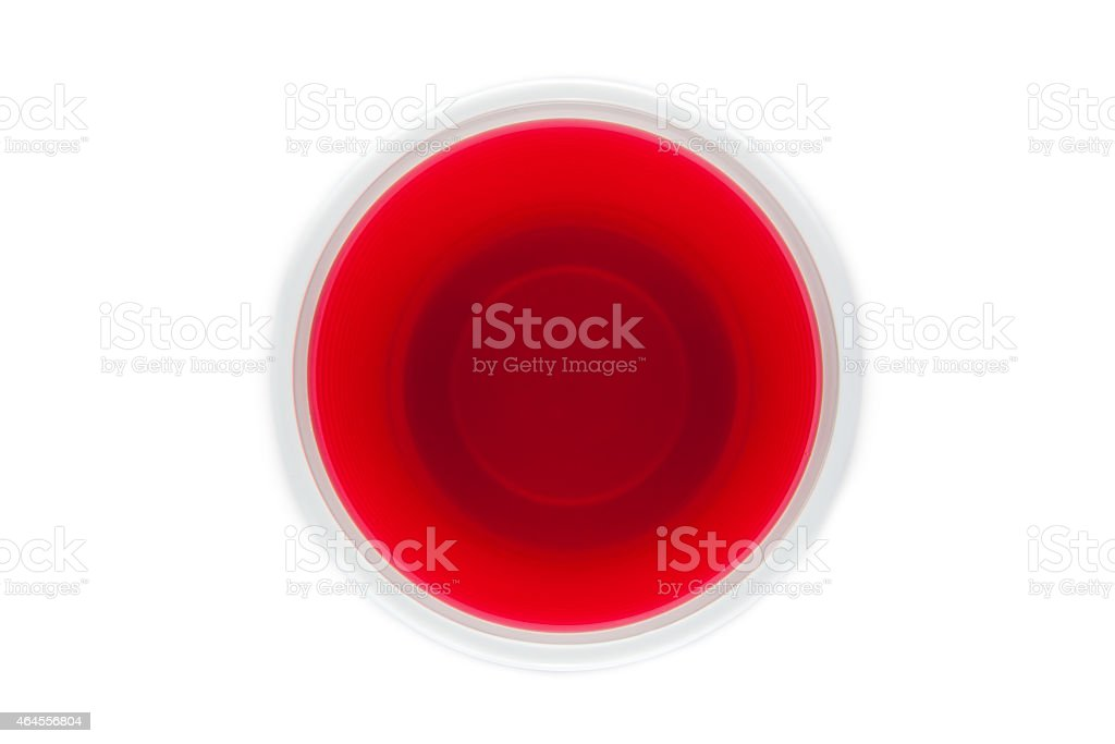 View from above of a plastic cup with red drink stock photo