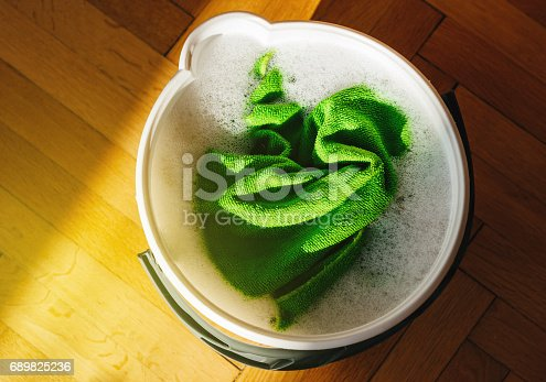 istock View from above of bucket full with water and cloth 689825236