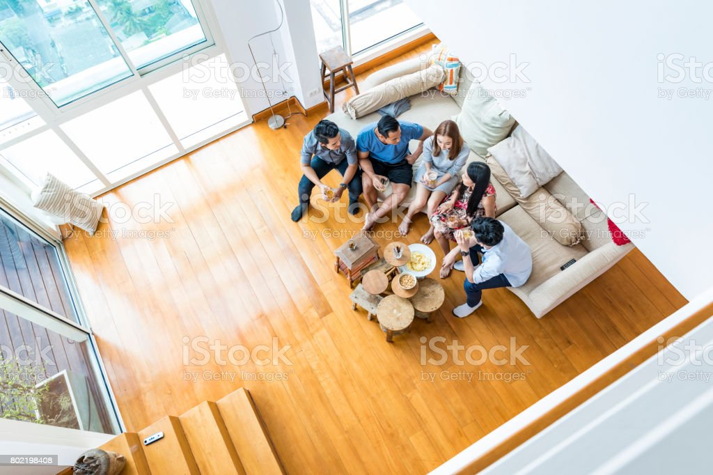 View From Above Of Celebrating Asian Group of Friends at a Party stock photo