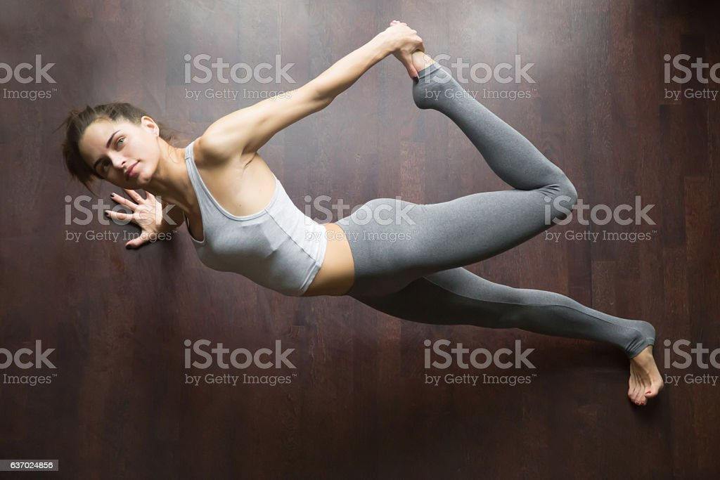 View from above of Partridge yoga Pose stock photo
