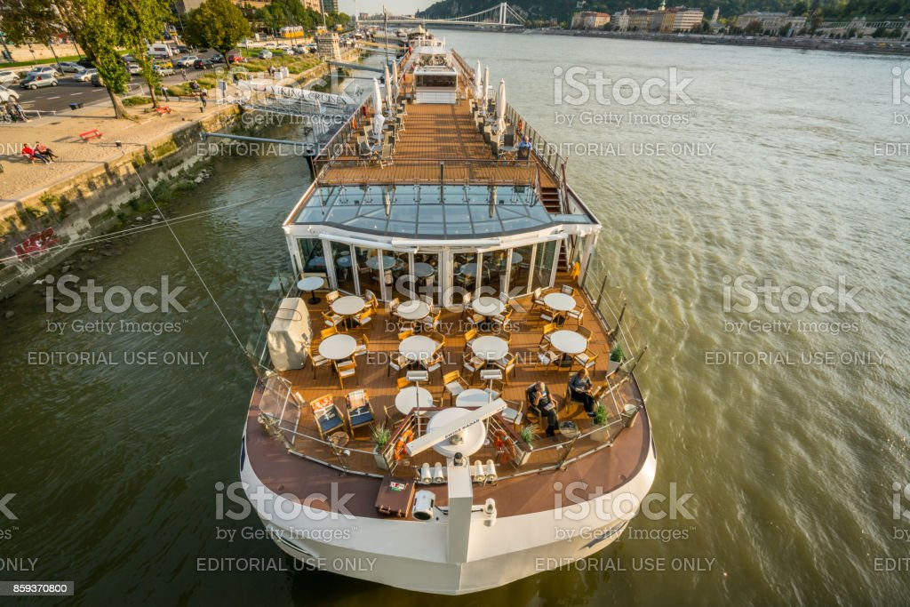 View from above of Viking Cruises canal boat cruise ship at the Danube river in Budapest. stock photo