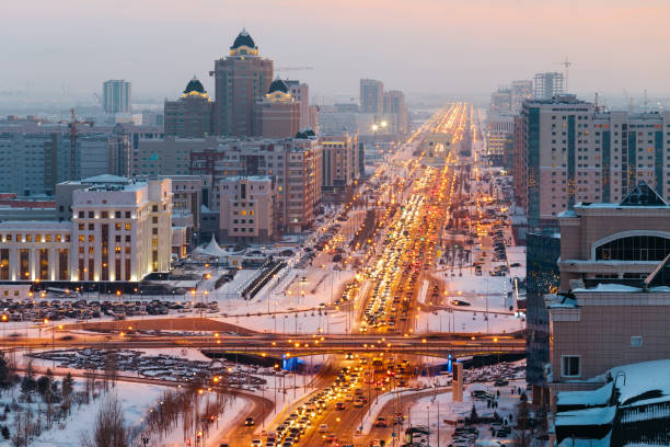 View from above on a large avenue that goes to the horizon in Astana, Kazakhstan. stock photo