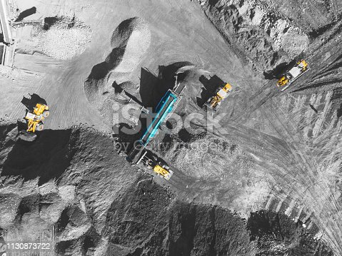 istock View from above, on the process of sorting coal mined. Open pit mine, Mining coal extractive industry anthracite. 1130873722