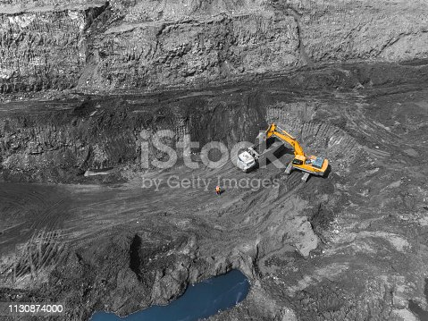 istock View from above, on the process of sorting coal mined. Open pit mine, Mining coal extractive industry anthracite. 1130874000