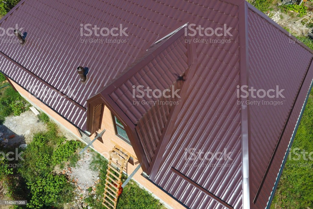 A View From Above On The Roof Of The House The Roof Of Corrugated Sheet Roofing Of Metal Profile Wavy Shape Stock Photo Download Image Now Istock