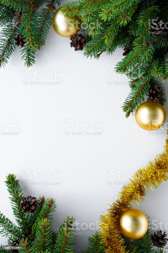 View from above on white table with christmas decoration arranged in...