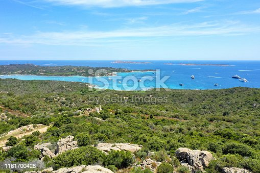 1066331604istockphoto View from above, stunning aerial view of a beautiful green coast bathed by a turquoise sea with some boats and yachts. Costa Smeralda (Emerald Coast) Sardinia, Italy. 1161700428