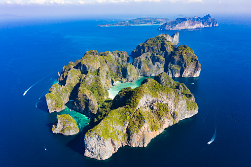 istock View from above, stunning aerial view of Koh Phi Phi Lee with the beautiful beach of Maya Bay bathed by a turquoise and clear water. Amazing ridges of limestone mountains surround this magnificent island of Thailand. 1132912714