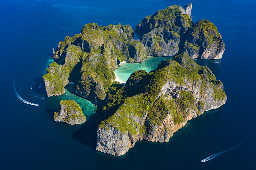 istock View from above, stunning aerial view of Koh Phi Phi Leh (Phi Phi Islands) with the beautiful Maya Bay. A turquoise and clear water bathes a white beach surrounded by limestone mountain. 1145282298