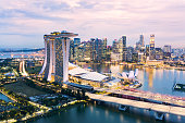 istock View from above, stunning aerial view of the skyline of Singapore during a beautiful sunset with the financial district in the distance. Singapore. 1257789908