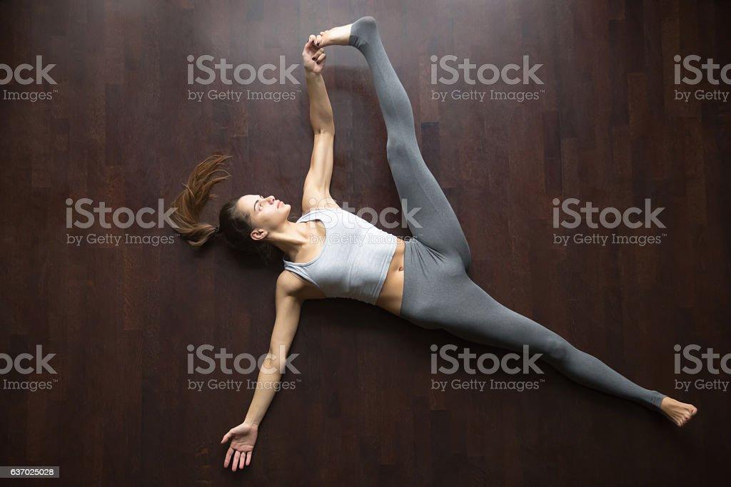 View from above. Supta Padangushthasana yoga pose stock photo