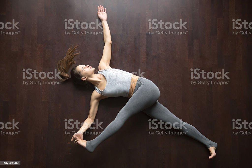 View from above. Supta padangustasana yoga pose stock photo