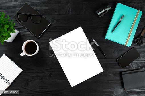 istock View from above with copy space office table , notebook with cup of coffee and Smart Phon 682672658