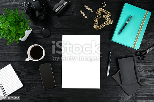 istock View from above with copy space office table , notebook with cup of coffee and Smart Phon 682674948