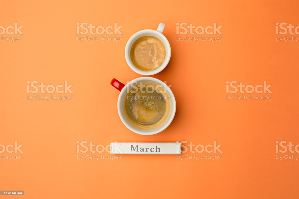 View from above with two cups of coffee with copy space. Background for woman day, 8 March. Orange table stock photo