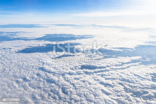 istock View from airplane window above the clouds 667255560