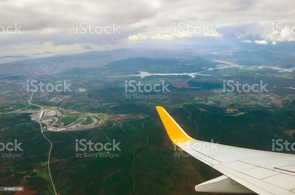 View from airplane window earth ground river and clouds travel...
