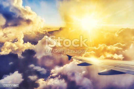 1045890176 istock photo View from airplane window on the wing at sunset time 1252711662