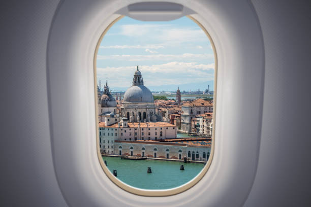 View from airplane window on Venice city in Italy. stock photo
