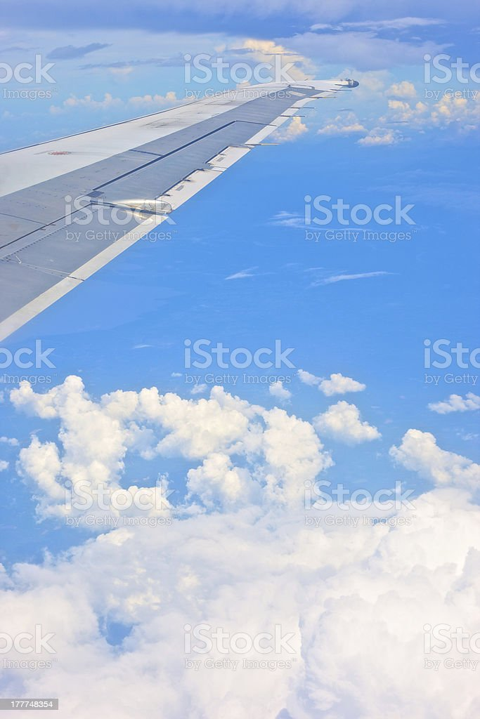 view from airplane window - wing on the clouds royalty-free stock photo