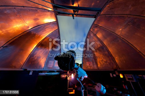 A telescope in a domed observatory at the Norman Lockyer Observatory, Sidmouth, UK