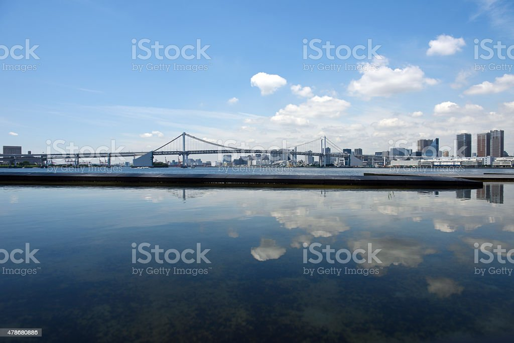 View from artificial pond at Tokyo Bay and urban skyline stock photo