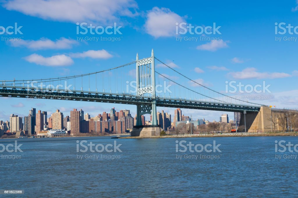 A view from Astoria, Queens of the RFK (Triborough) Bridge high above the East River in New York City stock photo