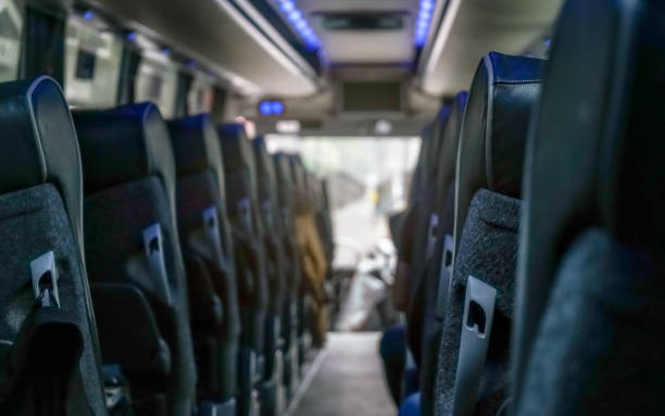 View from back seat at coach bus, more seats in blurred background stock photo
