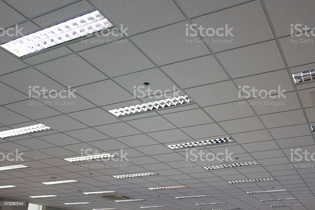A view from below of the lights on an office ceiling stock photo