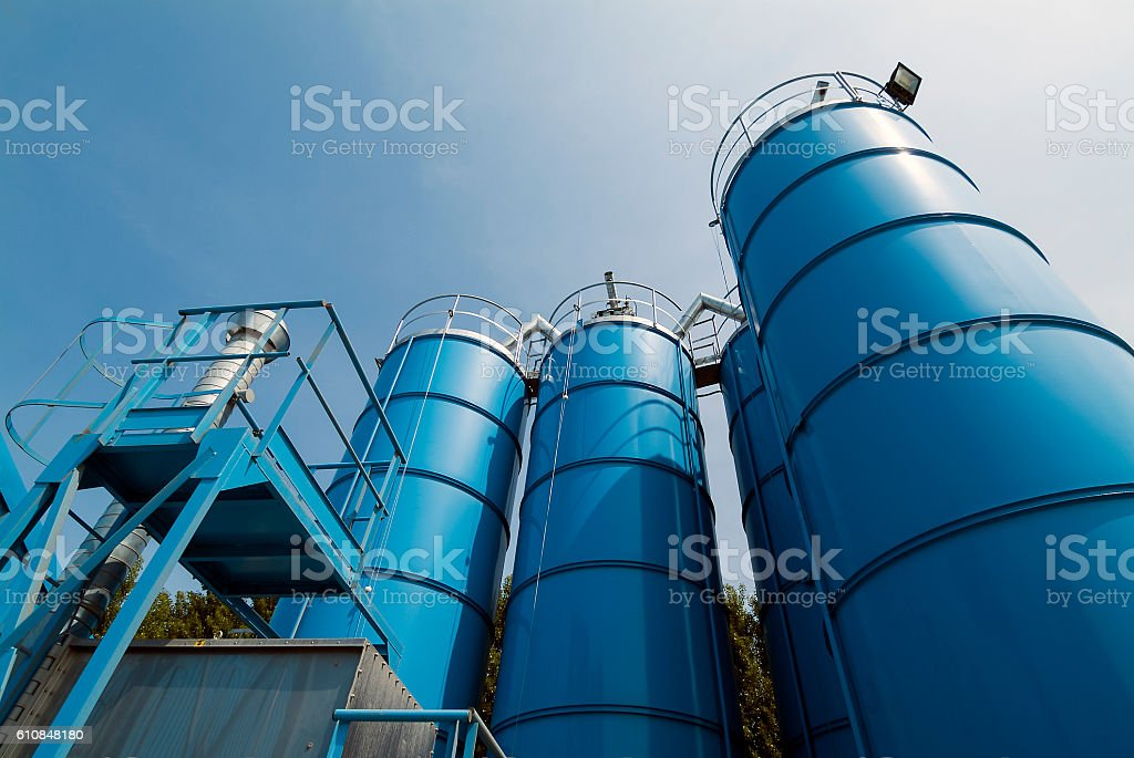 View from below of Tower Silos Bulk Storage stock photo