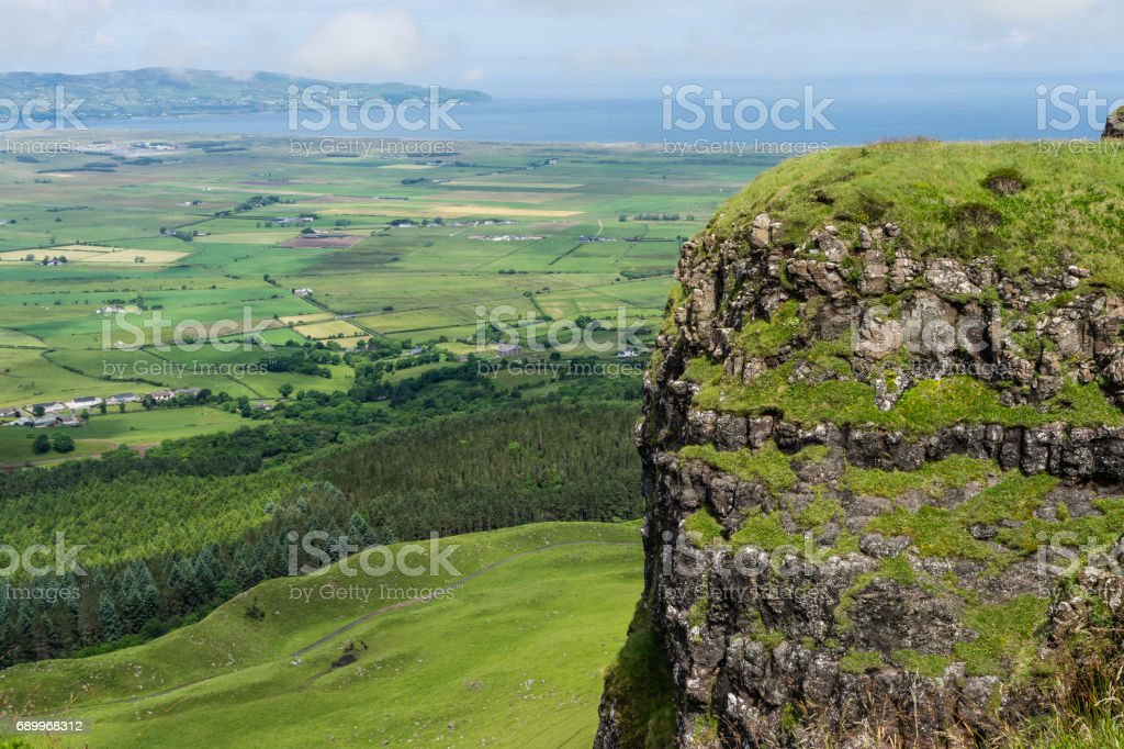 View from Binevenagh Mountain, over fields and coastline below stock photo
