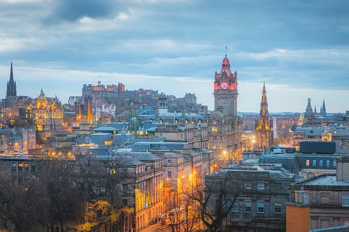 Cityscape night view from Calton Hill of illuminated Edinburgh old town skyline, Princes Street, Balmoral Clock Tower and Edinburgh Castle in the capital city of Scotland.