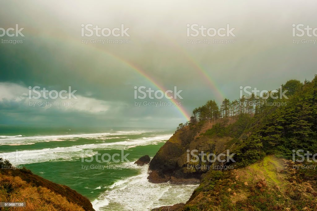 View from Cape Disappointment of Double Rainbow over the ocean. stock photo