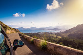 View from car at beautiful summer vacation landscape.. Port, sea, mountains. Traveling photo