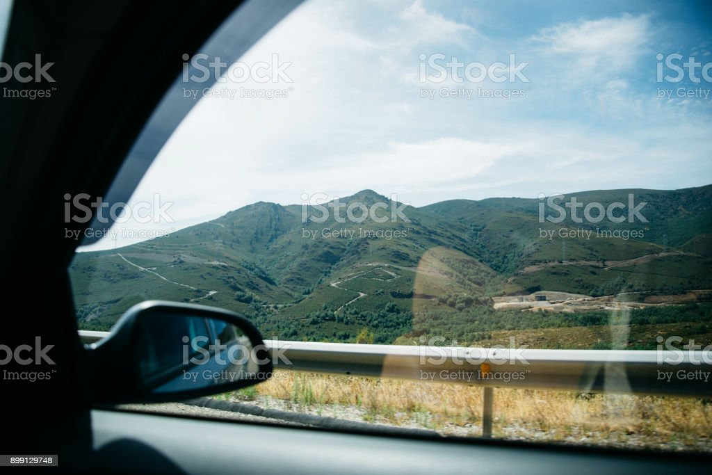 View from car window on green hills stock photo