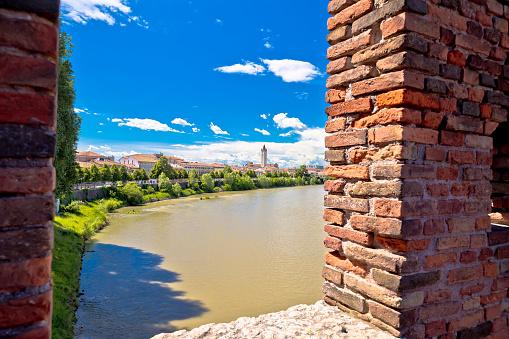 View from Castelvecchio Bridge on Adige river in Verona, famous landmark in tourist destination in Veneto region of Italy