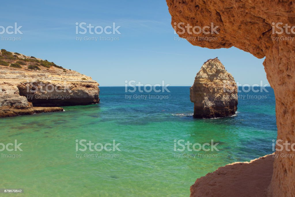 View from cliff on beach in Algarve stock photo