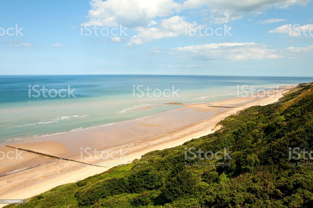 view from cliffs of cromer beach on perfect summer day stock photo