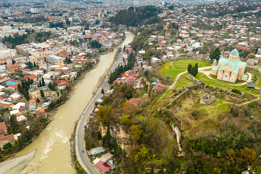 Picturesque aerial view of Georgian town of Kutaisi surrounded by hills