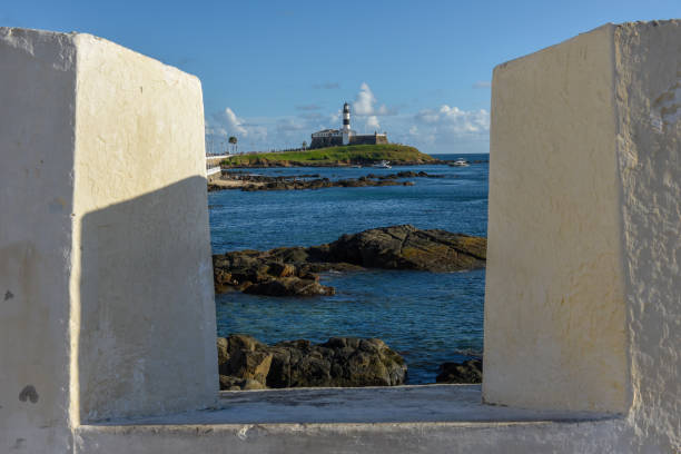 View from Fort of Santa Maria to Barra lighthouse in Salvador Bahia, Brazil stock photo