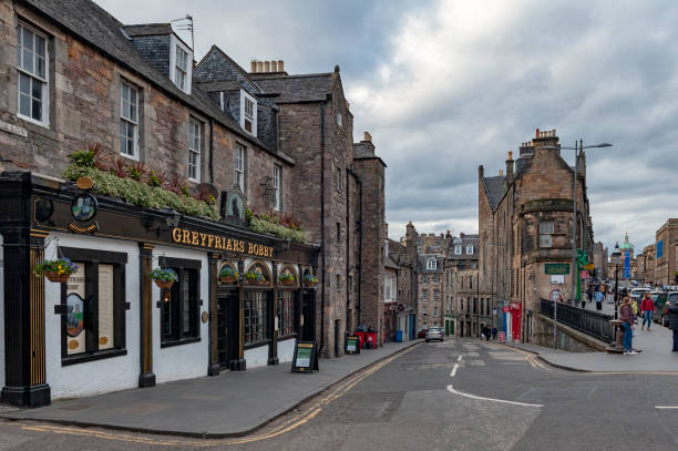 View from George IV Bridge towards Candlemaker Row Street alongside with historic buildings in city center of Edinburgh, Scotland, UK stock photo