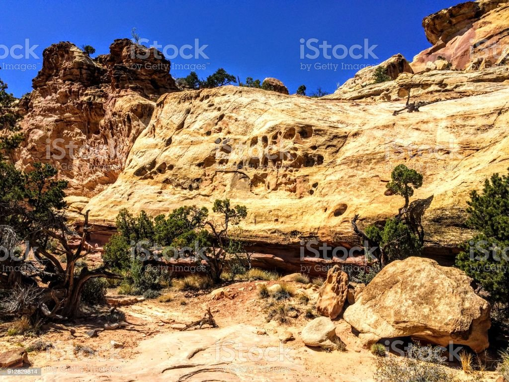 View from Hickman Bridge Arch trail in Capitol Reef National Park, Utah, USA. Grand view of cliffs, geographic formations and vegetation stock photo