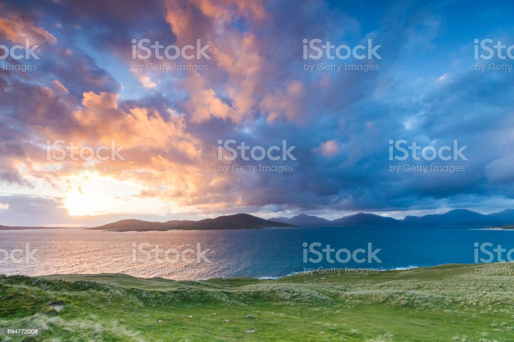 View from Horgabost in Harris to Taransay and Huisinis hills beyond at sunset stock photo