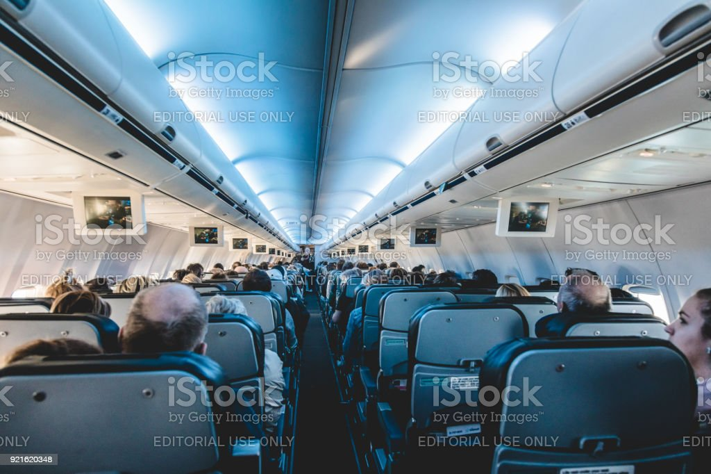 View From Inside Air Transat Airplane Of The Back Seats Stock Photo
