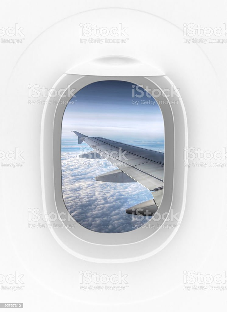 View from inside of plane through airplane window at wing stock photo