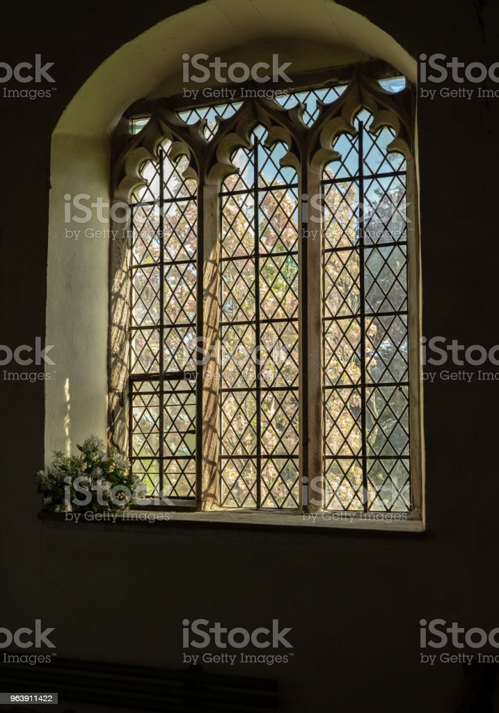 View from inside old church to blossom tree outside - Royalty-free Ancient Stock Photo