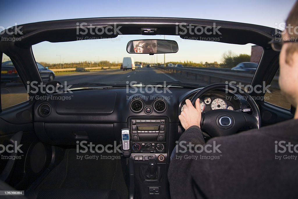 View from inside sports car of man driving royalty-free stock photo
