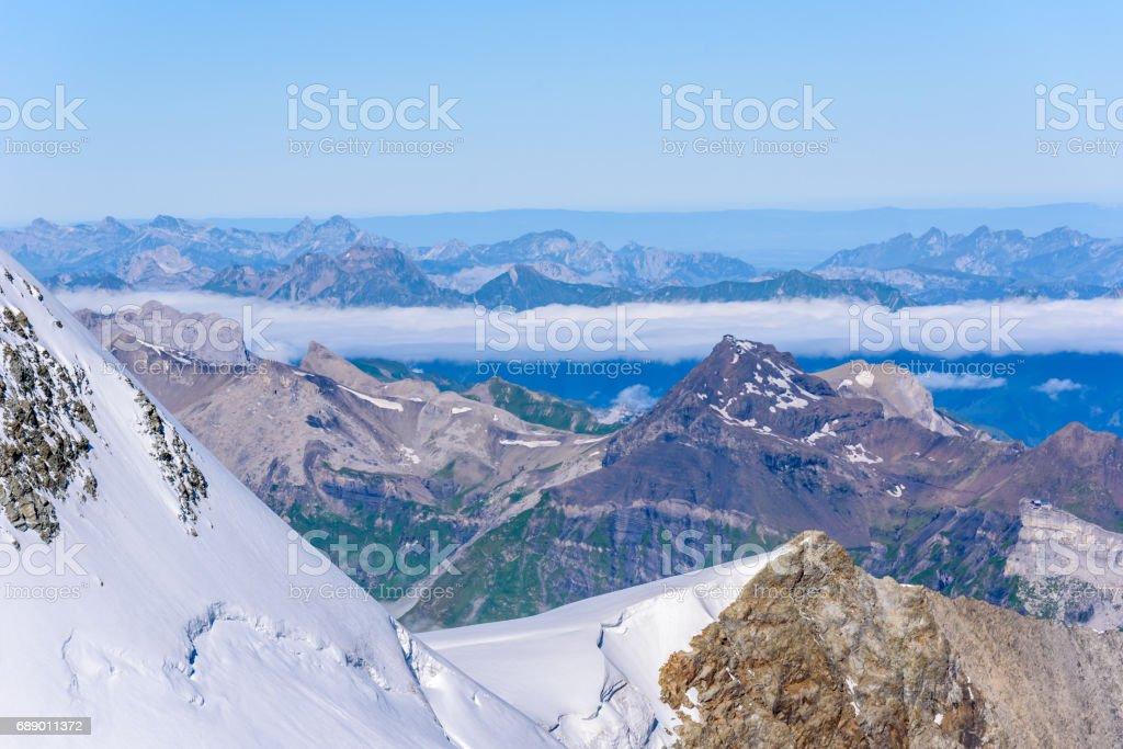 View from Jungfraujoch platform to the Bernese Alps in Switzerland stock photo