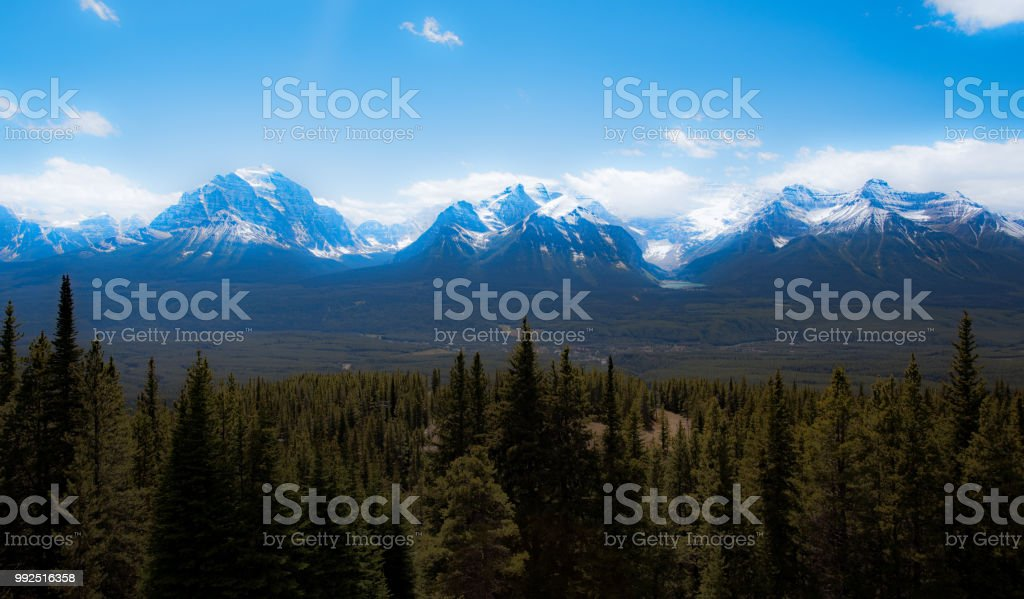 View from Lake louise Gondola across   valley  to Lake Louise surrounded by  snow covered mountains stock photo